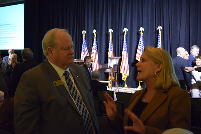 Chief  Deputy Oakland County Executive Gerald Poisson speaks with Michigan Secretary of State Ruth Johnson at Oakland County Executive L. Brooks Patterson's 2017 State of the County Address in Pontiac on Wednesday, Feb. 8, 2017. (Mark Cavitt/The Oakland Press)
