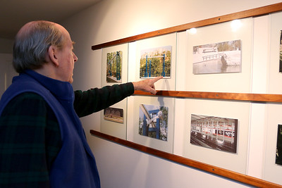 Paul Matisse talks about many of his installations he has made over the years as he points out pictures of them at his Kalliroscope Gallery in Groton on Tuesday morning. SUN/JOHN LOVE