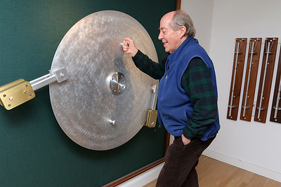 """Paul Matisse talks about his art piece he calls """"The Second Wheel"""" that spins and has lights at his Kalliroscope Gallery in Groton on Tuesday morning. SUN/JOHN LOVE"""