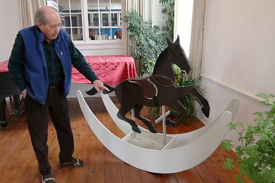 Paul Matisse talks about his rocking horse art piece at his Kalliroscope Gallery in Groton on Tuesday morning. SUN/JOHN LOVE