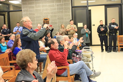Charles Pritchard - Oneida Daily Dispatch Residents applaud as Oneida City Police Chief Paul Thompson takes the oath of office on Tuesday, Nov. 21, 2017, at City Hall.