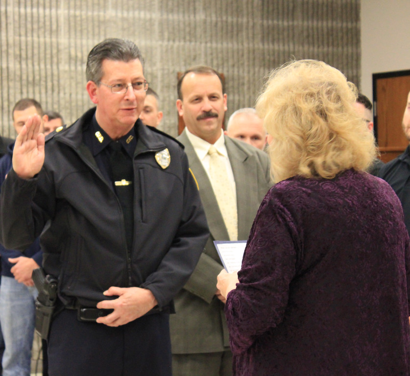 . Charles Pritchard - Oneida Daily Dispatch Oneida City Police Chief Paul Thompson takes the oath of office on Tuesday, Nov. 21, 2017, at City Hall.