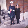 Jean Lantz with Peter and Paul by front steps. Paul in dark topcoat and gray hat.