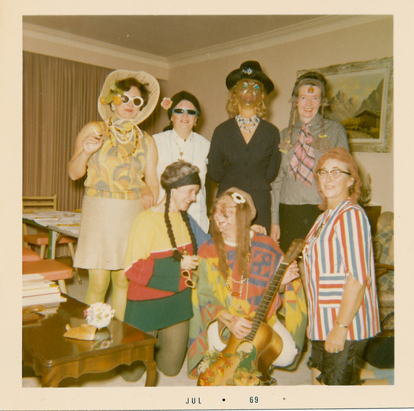 """Jean Lantz and other women dressed in """"hippie"""" costumes in living room. July 1969"""
