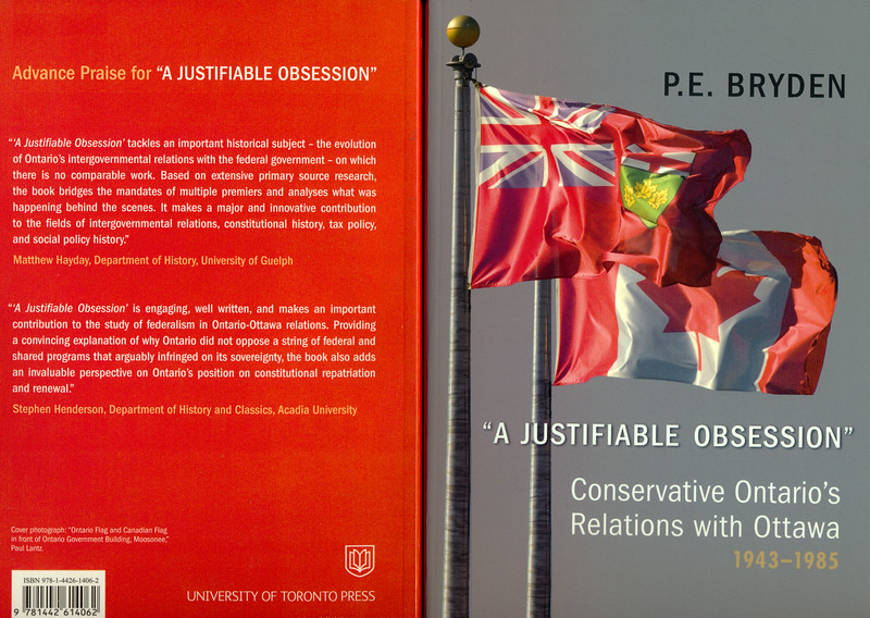 """Front and back covers of """"A Justifiable Obsession"""" Conservative Ontario's Relations with Ottawa 1943-1985 by P. E. Bryden, University of Victoria. Cover photo by Paul Lantz of flagpoles with Ontario and Canadian flags at Ontario Government Building in Moosonee."""