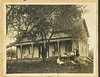 Picture of house with group of people in front. Presumably from Normanby Township. Lantz