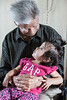 Abraham Metatawabin holding an infant 2012 October 7th in Fort Albany.