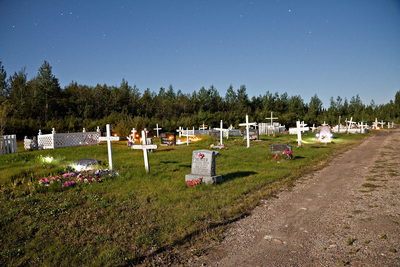 Moosonee Public Cemetery under the light of a full moon. The cemetery at night glows with the solar lights that people have installed.<br /> This is a night time exposure shown as shot (compare to the nearby version of this one which is four stops darker, one issue with night time shots is how bright to make them, especially with a full moon it is easy to make shots that look pretty much like daylight but a little different because the moon is the source of illumination.