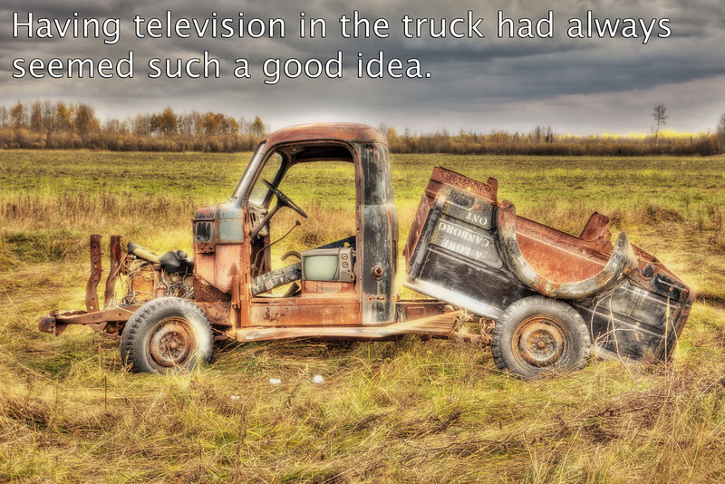 Old truck along Bear Road - Having television in the truck had always seemed such a good idea.