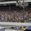 May 26: Tony Kanaan takes the checkered during the 97th running of the Indianapolis 500 mile race.
