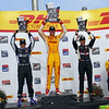 June 15: Victory podium during the Izod IndyCar series race at the Milwaukee Mile.