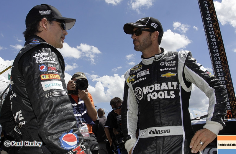 NASCAR Sprint Cup teammates Jimmie Johnson, Jeff Gordon chat at Indianapolis Motor Speedway while qualifying for the Brickyard 400.