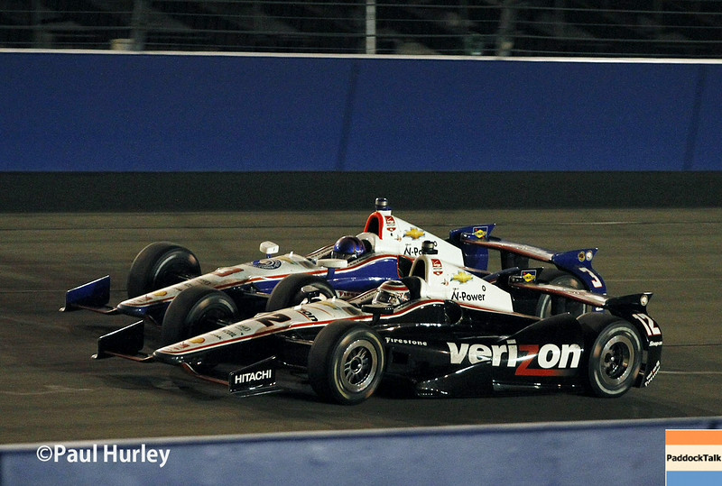 August 30:Will Power and Helio Castroneves during the MAVTV 500 race at Auto Club Speedway.