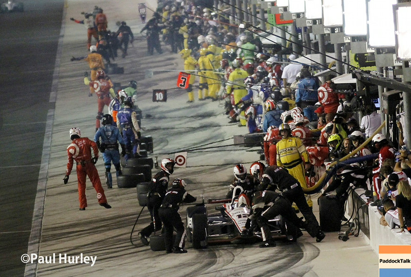 August 30:Pit stops during the MAVTV 500 race at Auto Club Speedway.