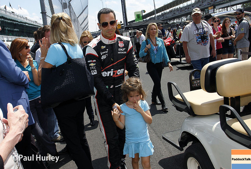 May 10: Helio Castroneves and daughter during the Grand Prix of Indianapolis.