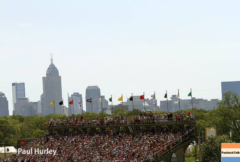 May 25: The crowds and Indianapolis skyline before the 98th Indianapolis 500.