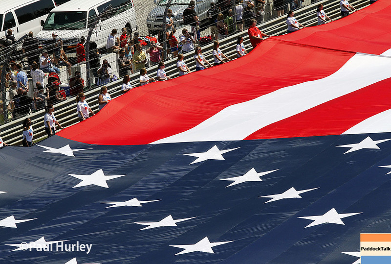 May 25: The American flag before the 98th Indianapolis 500.