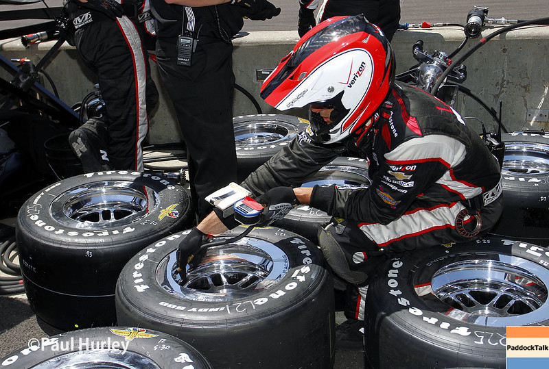 May 25: Will Power crewman during the 98th Indianapolis 500.