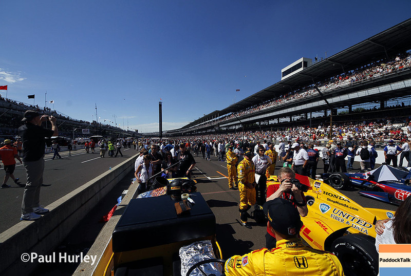 May 25: Pit lane activity before the 98th Indianapolis 500.