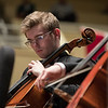 "Alexander Davis- Pegis, a cello student, from the Music School Festival Orchestra performs ""Symphonic Dances, Dance No.1: Hoe  Down"", composed by Bruce Stark on Monday, July 3, 2017 in the Amphitheater. PAULA OSPINA / STAFF PHOTOGRAPHER"