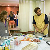 Chautauquan Scholars Shelby Frank, 19, and Krisztian Ha'ger, 21, prepare dishes from their home to be shared with other Scholars on Sunday, July 2, 2017 at the Ida Vanderbeck Chapel. PAULA OSPINA / STAFF PHOTOGRAPHER