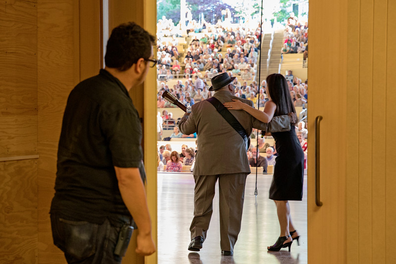 Vice President and Director of Programming Deborah Sunya Moore welcomes Austin Walkin Cane to the stage in the new Amphitheater on Saturday, June 24, 2017. PAULA OSPINA / STAFF PHOTOGRAPHER