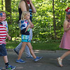 "From left to right: Reagan Abbott, Ellie Grant and Addison Steere walk to ""Party in the USA"" by Miley Cyrus during the annual Children School 4th of July Parade on Tuesday, July 4, 2017. PAULA OSPINA / STAFF PHOTOGRAPHER"