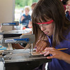 Ruby Wilson, 9, member of the Young Readers program cuts wood with a saw as part of the STE(A)M organization program on Wednesday, June 29, 2017 at Miller Bell Tower. PAULA OSPINA / STAFF PHOTOGRAPHER