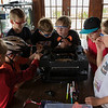 Kids from the Young Readers program participated in deconstructing a printer as part of the STE(A)M organization program on Wednesday, June 29, 2017 at Miller Bell Tower. PAULA OSPINA / STAFF PHOTOGRAPHER