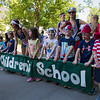 "Students from the Children's School walk to ""Party in the USA"" by Miley Cyrus during the annual Fourth of July Parade on Tuesday, July 4, 2017. PAULA OSPINA / STAFF PHOTOGRAPHER"