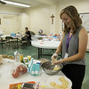 Chautauquan Scholar Shelby Frank, 19, prepares tofu sliders to share with other Scholars on Sunday, July 2, 2017 at the Ida Vanderbeck Chapel. PAULA OSPINA / STAFF PHOTOGRAPHER