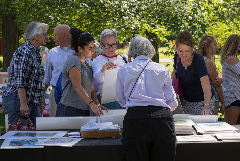 From left to right: Sarah Smith, Susan Smith and Kathleen Riley look at watercolor and oil paintings created by Alice W. Ronke on Sunday, July 2, 2017 in Miller Park during Art in the Park. PAULA OSPINA / STAFF PHOTOGRAPHER
