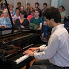 Student from Peabody Conservatory of Music, Jun Luke Foster, 24 plays the piano on Monday, June 26, 2017 at the Sherwood-Marsh Studios. Students played a three minute song of their own choosing as the start of the five week piano program. PAULA OSPINA / STAFF PHOTOGRAPHER