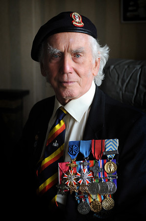 Pictured is World war 2 Veteran Ian Forsyth MBE at his home in Hamilton. Mr Forsyth was one fo the first British servicemen to arrive at the notorious Nazi concentration camp Bergen-Belsen on April 15, 1945. Paul Chappells 30/08/13