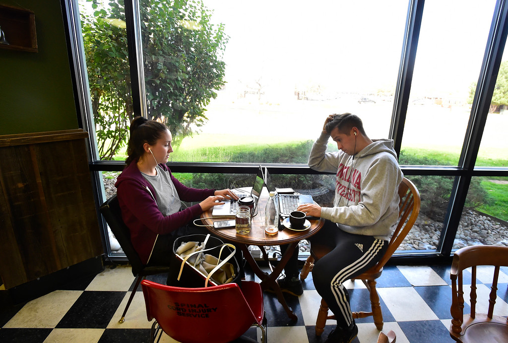 . BOULDER, CO OCTOBER 17 2018 Lauren Detweiler and her brother Alex work at Paul\'s Coffee & Tea in Louisville on Wednesday afternoon.  For more photos go to dailycamera.com (Photo by Paul Aiken/Staff Photographer)