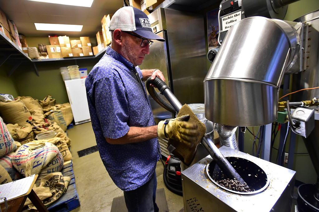 . BOULDER, CO OCTOBER 17 2018 Roger Cohn vacuums coffee beans from the roaster at Paul\'s Coffee & Tea in Louisville on Wednesday afternoon.  For more photos go to dailycamera.com (Photo by Paul Aiken/Staff Photographer)