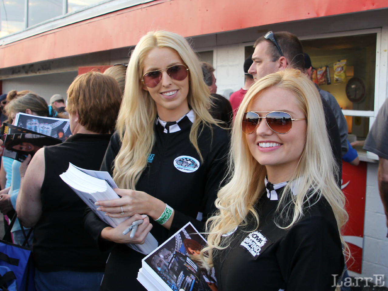 the Koma girls were handing out posters for the autograph session.
