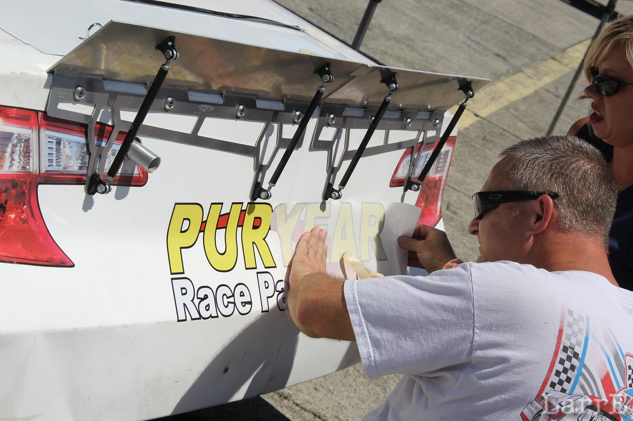 Puryear adds his name to the car