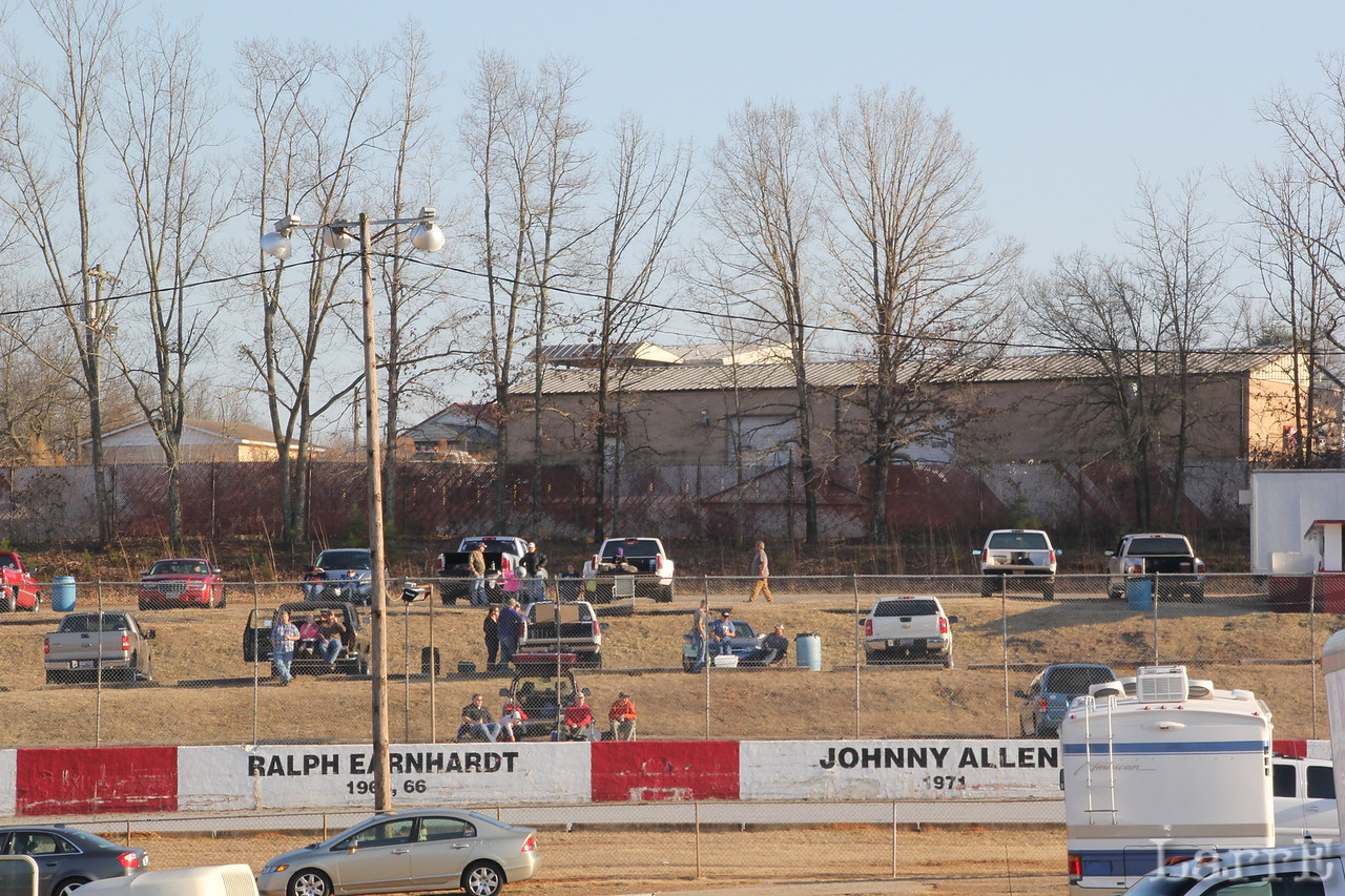 cars park on the hill off the backstretch.