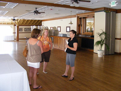 Leslie and Katrin discuss menu options with the Pavilion event planner
