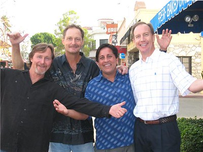 WELCOME TO THE NHHS CLASS OF 78's 30-YEAR REUNION!!!  Chris Corum, Jim Corum, Jack Manciet, and Bruce Louvier, all hands, arms, and smiles!  This photo is actually very fortuitous... The Corum brothers are out in the street, Manciet is under prescription drugs, and Louvier is half-baked!
