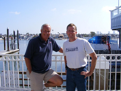 Class Reunion organizers from different decades-  Bob Black (NHHS '68) and Bill Beamish (NHHS '78).  Bob still runs the Catalina Flyer opperation in the Balboa Pavilion and was one of our 30 year reunion sponsors!