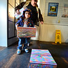 KRISTOPHER RADDER — BRATTLEBORO REFORMER<br /> Quentin Bauer, 3, of Hinsdale, N.H., helps his brother bring boxes into the Hinsdale Post Office on Wednesday, March 4, 2020.