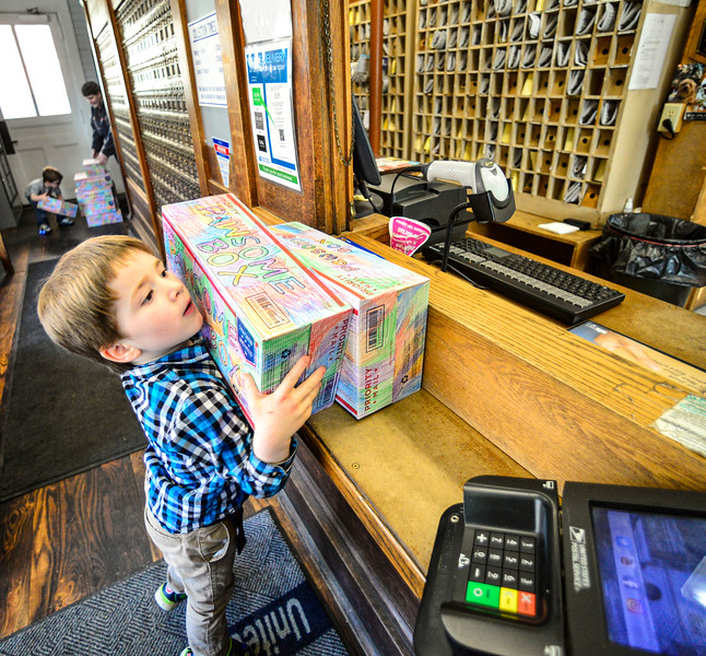 KRISTOPHER RADDER — BRATTLEBORO REFORMER<br /> Ryker Bauer, 5, of Hinsdale, N.H., brings care packages to the Hinsdale Post Office that he mails to various humane societies  on Wednesday, March 4, 2020. Bauer has mailed 112 packages as part of a project he created called Pawsome Box.
