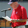 Jim Martin reads the starting lineups for the last time at McCoy.