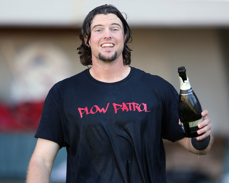 Hamilton offers some bubbly to Brock Holt.