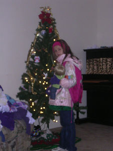Heather, ready for school, by the tree