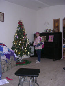 Heather, ready for school, by our tree