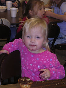 Kayla, enjoying birthday cupcakes