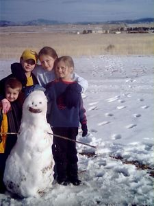 Justin, Jon, Frances, and Heather, behind their creation, the Snow Girl.